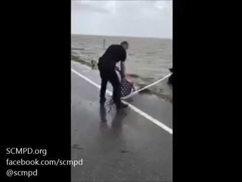 Police officer rescues flag after Hurricane Irma