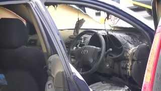 亘理町内パチンコ店の駐車場で運転席ハンドル前から爆発炎上した。