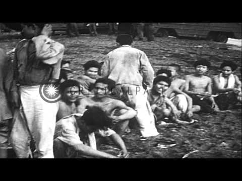 Military supplies offloaded from Landing Ships and naked natives are taken prison...HD Stock Footage from YouTube · Duration:  2 minutes 15 seconds