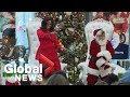 Michelle Obama dances with Santa during visit to Colorado children's hospital
