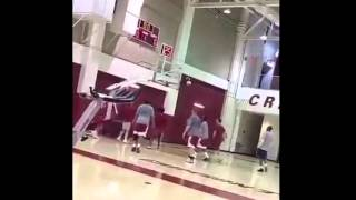 Watch Nick Saban hit a shot from the corner during a pick up basketball game