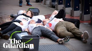 Extinction Rebellion protesters stage 'die-in' outside London fashion week venue