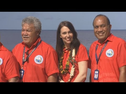 Jacinda Ardern and Pacific leaders sport matching red threads during Nauru photo shoot