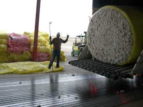 unwrapping cotton bales at broadview co op gin firebaugh ca.