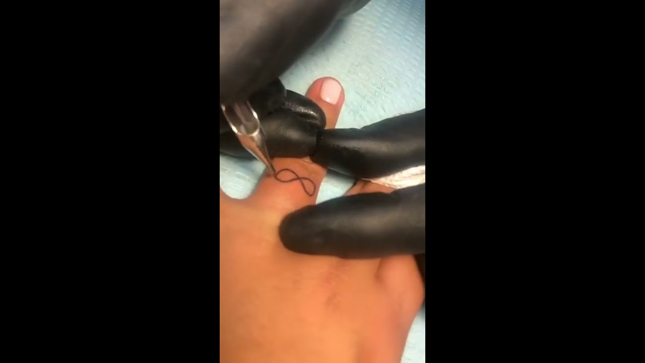 His & Hers infinity tattoo slow motion #tattooing