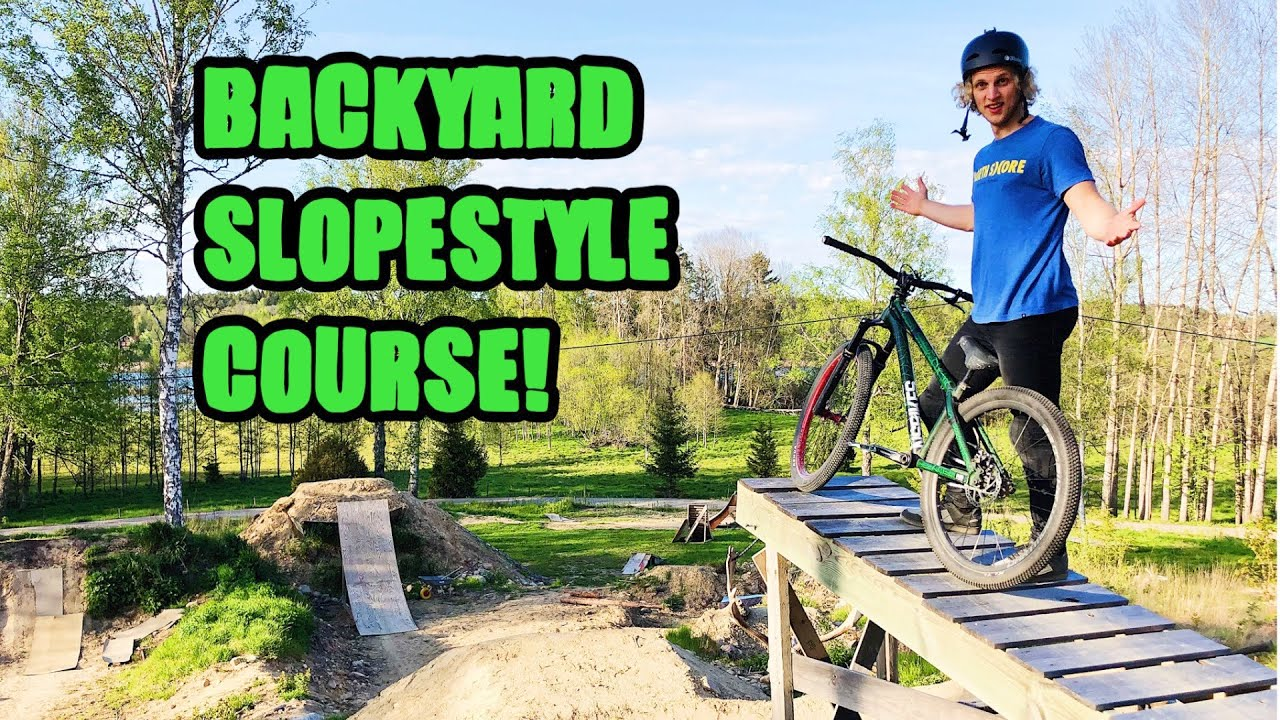 Download RIDING THIS CRAZY BACKYARD SLOPESTYLE COURSE!
