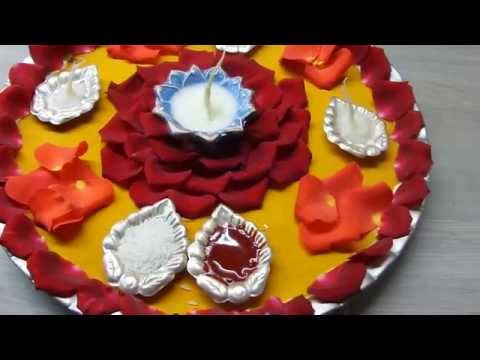 Puja thali videos for Aarti thali decoration with rice