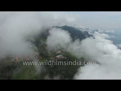Coonoor town with tea gardens, with clouds moving in over Nilgiri hills