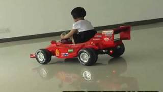Red Ferrari F1 ride on race car for kids