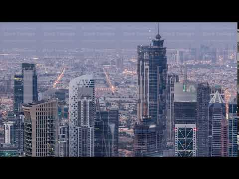 Dubai Downtown skyline futuristic cityscape with many skyscrapers and Burj Khalifa aerial night to