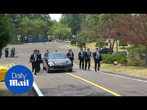 Kim Jong Un's body guards run alongside car carrying official - Daily Mail
