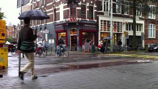 Street Traffic in Amsterdam: Bikes, Scooters, Cars, Trams and Walkers