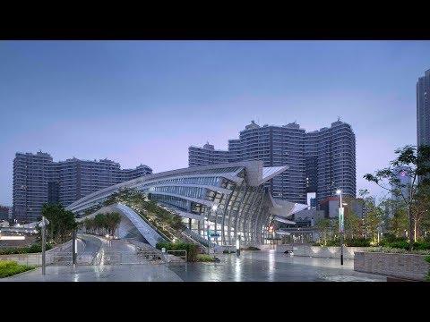 Arching rooftop walkway tops Aedas' West Kowloon Station in Hong Kong