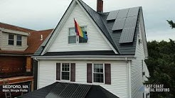 Medford, MA - Black Metal Roof with Solar Panels