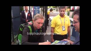 Vera Zvonareva - Signing Autographs at the 2011 U.S. Open in Flushing Meadows