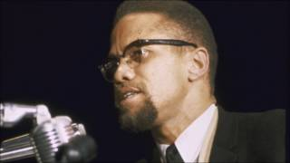 Malcolm X emphatically declares shahada (statement of faith) in Arabic and English