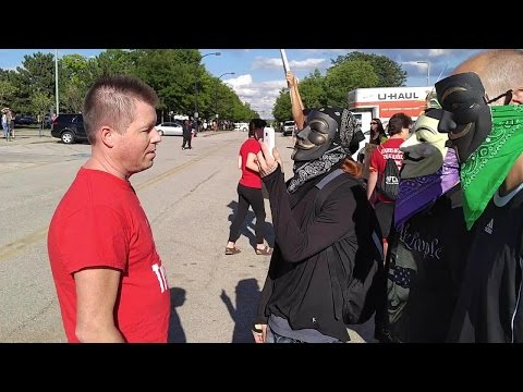 Anonymous Vs. Trump Supporter At Akron Trump Rally Protest