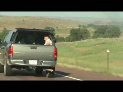 Driving in Wyoming - People in back of car