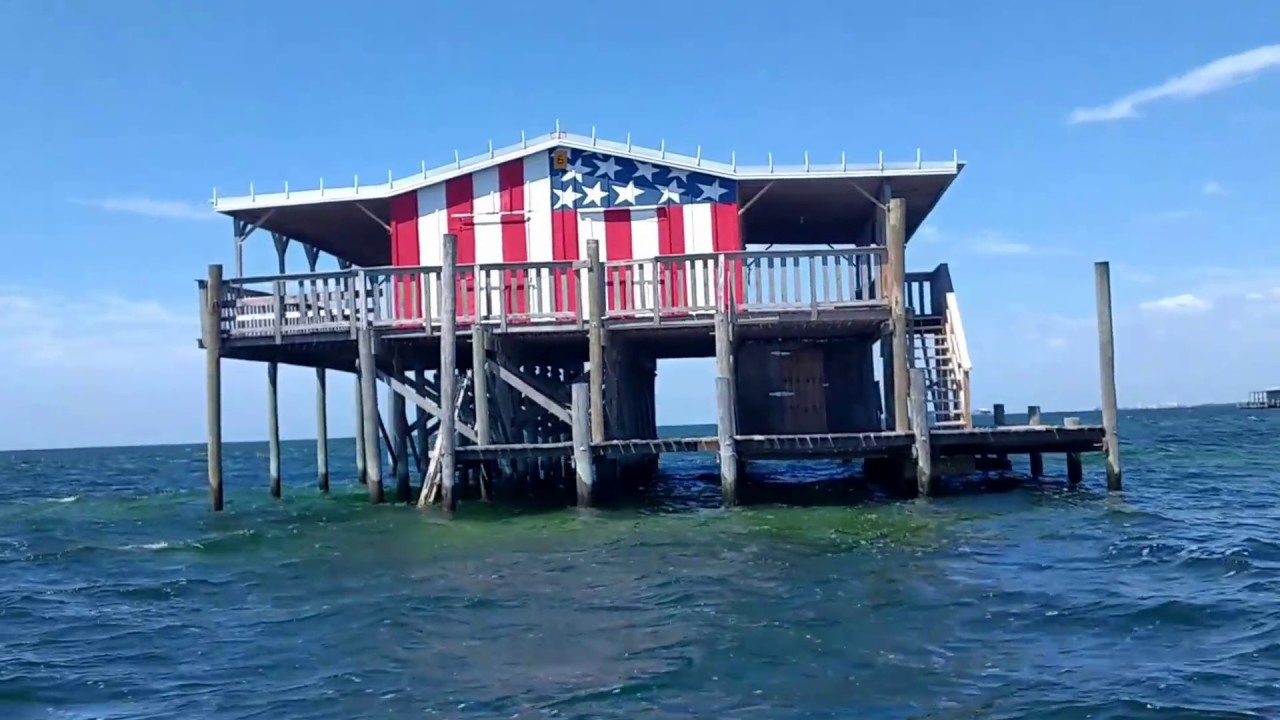 Stilt houses in the gulf of mexico viewed close up by boat