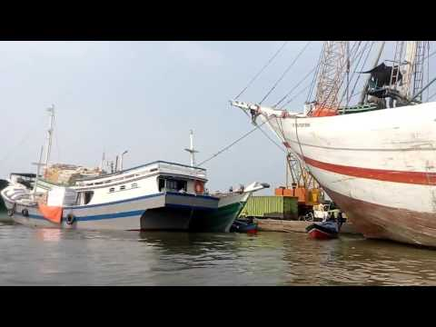 Jakarta harbour and fisherman village over water