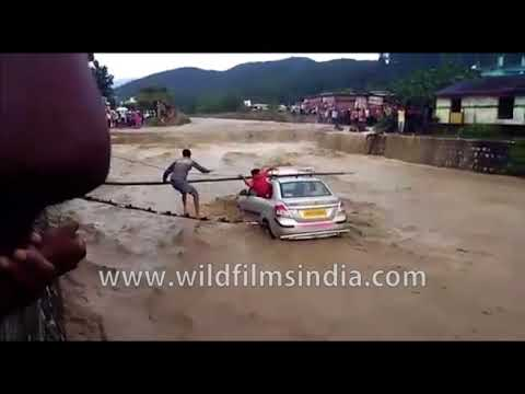 Flood victims rescued from a submerging car