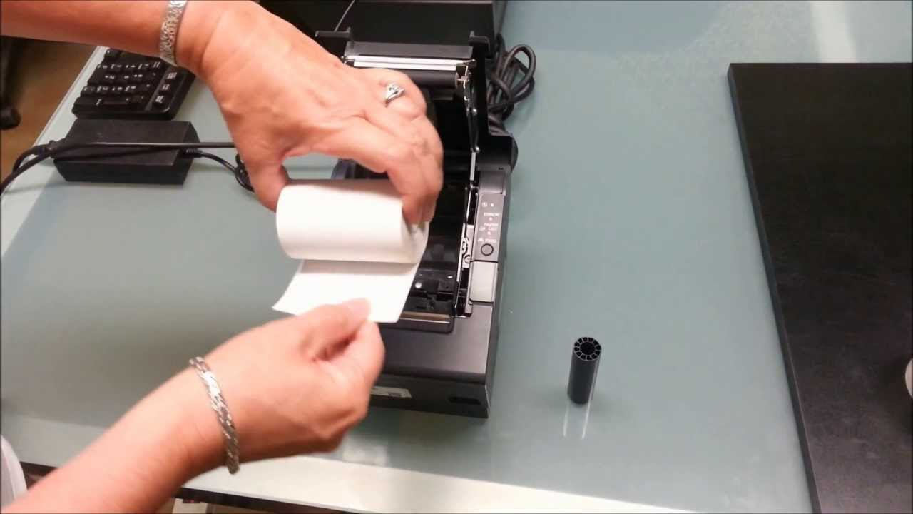 changing the thermal paper in an m129 printer