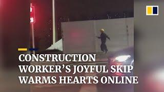 Chinese construction worker's joyful skip warms hearts online