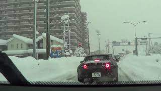 Driving in heavy snow. (Niigata City, Japan)