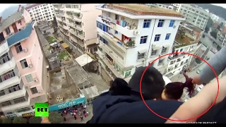 Dramatic GoPro  Man saves suicidal wife from falling to death by grabbing her hair