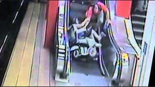 EPIC FAIL Wheelchair Woman OWNED by ESCALATOR (poor lady but funny)