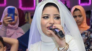 عروسه تغني لعريسها (انت سندي )وتبهر الجميع بجمال صوتها