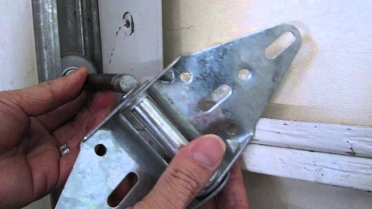 How To Repair A Broken Garage Door Hinge Or Replace A Roller Youtube