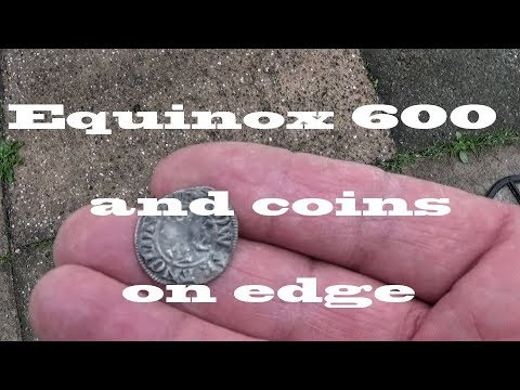 RMD.... coins on edge with Equinox, and a wooden metal detector... ( 142 )
