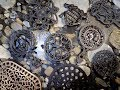 A Small Collection Of Cast Iron Trivets