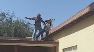 VIDEO   Hero grandpa forces intruder off roof