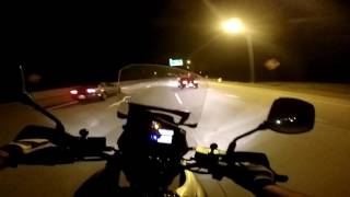 Motorcycle racing Mustang GT on the highway