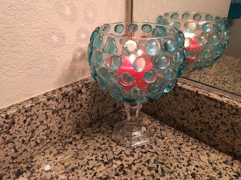 Reuse Your Fishbowl As A Cool Candle Holder.