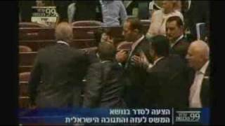 Politicians get physical in Israel raid debate