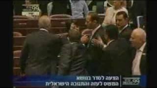 Politicians get physical in Israel raid debate