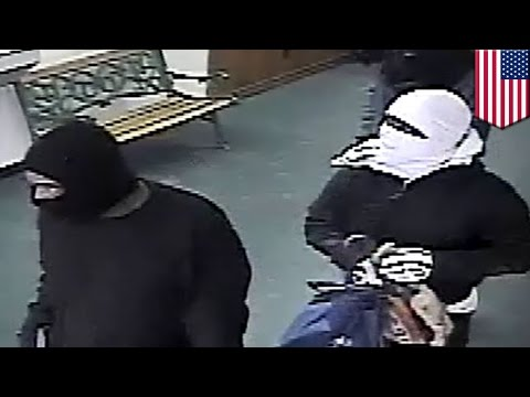 Check-cashing Robbery Video: Gunmen Caught Sticking Up Houston Businesses On Surveillance