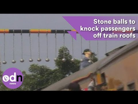 Stone balls to knock passengers off Indonesian train roofs