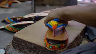 Shoemaker in the process of making colorful Sandal