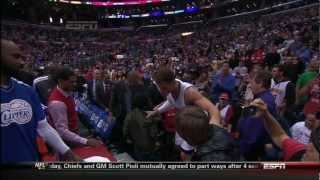 Blake Checks on Young Fan After Dive