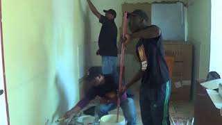 SAHRC staff painting a wall as part of Mandela Day