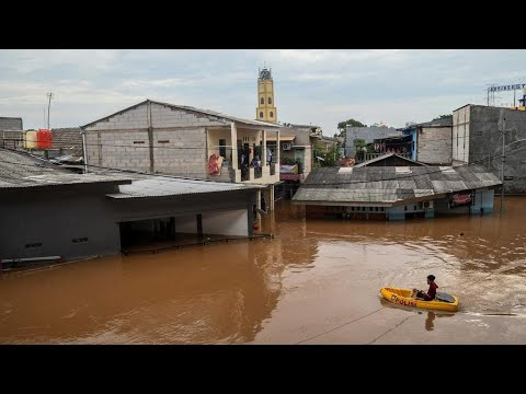 Death toll doubles in Indonesia New Year flood as tens of thousands still displaced