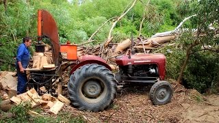Home made Tractor powered log splitter in action