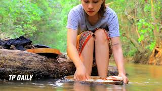 Primitive Beautiful Girl Cooking Fish Recipe On The River In Forest