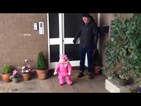 Cute baby sees snow for the first time.  Great reaction