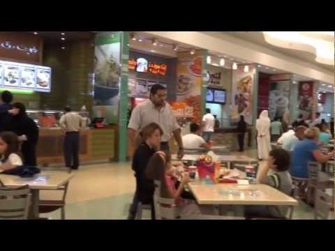 Bahrain, crowded fastfood corner in a megamall
