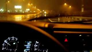 2013 Toyota Avalon Limited on the highway on a rainy night doing 70 mph